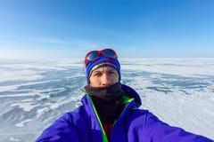 Selfies man on background blue ice of Baikal Stock Image