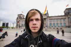 Selfies Photo Man with blond hair on the background of the Reichstag in Berlin. Stock Photography