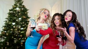 Selfies Photo New Year Party, beautiful girls take pictures mobile phone, girls drinking wine from a glass of wine stock video