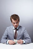 Selfish man. A young man counts the money Stock Images