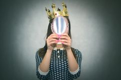 Selfish woman. Egoistical person. Selfish woman. Arrogant disgruntled girl with high self esteem. Egoist person woman with golden crown on her head royalty free stock photos