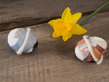 Selfmade easter eggs with a flower. Some selfmade easter eggs taped with newspaper with a yellow flower Stock Photo