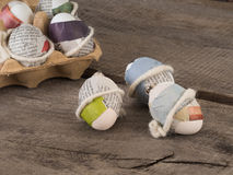 Selfmade easter eggs. Some selfmade easter eggs taped with newspaper on a wooden table Stock Images