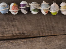 Selfmade easter eggs on a wooden table – season background Royalty Free Stock Images