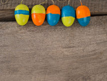 Selfmade painted easter eggs – season background. Some selfmade painted easter eggs on a wooden background with copy space Stock Image