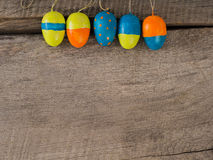 Selfmade painted easter eggs – season background. Some selfmade painted easter eggs on a wooden background with copy space Royalty Free Stock Photo