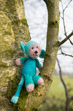 Selfmade stuffed monkey in tree. Crocheted selfmade monkey toy sitting in tree Royalty Free Stock Photo