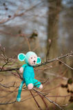 Selfmade stuffed monkey in tree. Crocheted selfmade monkey toy sitting in tree Stock Photography