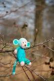 Selfmade stuffed monkey in tree Stock Photography
