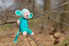 Selfmade stuffed monkey in tree Stock Photos