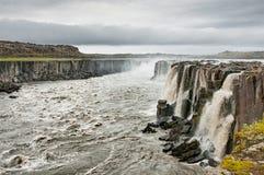 Selfoss Waterfall. The bubbling, muddy waters of the Selfoss waterfall under gray, rainy skies, Iceland Stock Photography