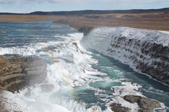Selfoss waterfall with ice and rainbow Royalty Free Stock Image