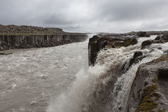 Selfoss waterfall near famous Dettifoss in. Selfoss waterfall near famous Dettifoss in Vatnajokull national park in Northeast Iceland. Huge basalt lava columns royalty free stock image