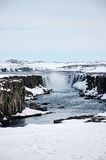 Selfoss waterfall, west bank, snow, cloudy, Iceland Royalty Free Stock Photos