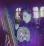 Selfportrait of artist painting the world around her Royalty Free Stock Photos