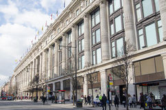 Selfridges Department Store, London. LONDON, ENGLAND - MARCH 13: Shoppers walking past the famous Selfridges Department Store on Oxford Street, central London on Stock Image