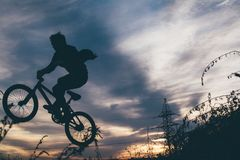 Selhouette Photo of Man Riding Bmx Bike Stock Photography