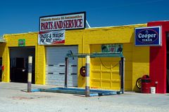 SELIGMAN ARIZONA, USA - AUGUST 14. 2009: View on yellow repair shop against blue sky royalty free stock image