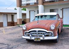 Rusty abandoned Packard car. Seligman, Arizona, Usa � July 24, 2017: Rusty abandoned Packard car in Seligman, Arizona Stock Photos