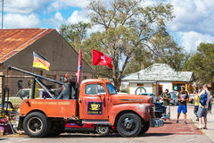 Tourists and Old Tow Truck. SELIGMAN, AZ - SEPTEMBER 16: Tourists take pictures of an old tow truck on Route 66 in Seligman, AZ on September 16, 2015 Royalty Free Stock Image