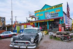 Chrysler Police Car in front of Historic Seligman Sundries Cafe. Royalty Free Stock Photos