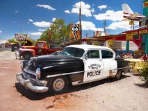 Vintage Police Car, USA. Seligman - The historic town on U.S. Route 66. Vintage police car and stores, street view. Arizona. USA stock photo