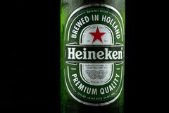 Selinsgrove, Pennsylvania - March 18, 2019: A bottle of Heineken beer isolated against a black background. royalty free stock photos