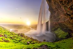 Free Seljalandfoss From Behind Cave Interior, Iceland Stock Image - 150719271