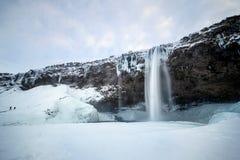 SELJALANDFOSS/ICELAND - FEBRUARI 02: Sikt av den Seljalandfoss vattenfallet Arkivfoto