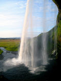 Seljalandfoss Waterfall (Iceland). Seljalandsfoss is a waterfall in Iceland situated in between Selfoss and Skógafoss at the road crossing of the Ring Road Stock Photos
