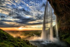Seljalandfoss waterfall at sunset in HDR, Iceland Stock Photos