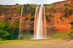 Seljalandsfoss. Is one of the most beautiful waterfalls on the Iceland. It is located on the South of the island. This photo is taken during the incredible royalty free stock photos