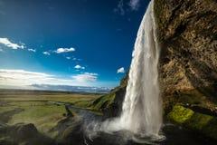 Seljalandsfoss famous Icelandic waterfall Iceland. Seljalandsfoss spectacular waterfall Scandinavian landscape lovely sunny day famous place Iceland Europe stock photo