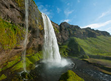 Seljalandsfoss. Is one of the most beautiful waterfalls on the Iceland. It is located on the South of the island. With a rainbow stock images