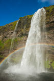 Seljalandsfoss. Is one of the most beautiful waterfalls on the Iceland. It is located on the South of the island. With a rainbow stock photo