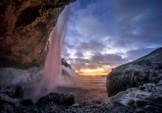 Seljalandsfoss sunset. Colorful sunset at Seljalandsfoss waterfall in winter, Iceland royalty free stock images