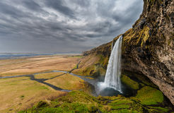 Seljalandsfoss Waterfall in Iceland. One of the ost Famous Waterfall in Iceland. Cloudy Sky. Wide Angle. Royalty Free Stock Image