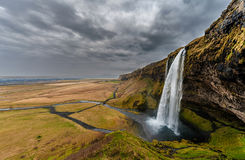 Seljalandsfoss Waterfall in Iceland. One of the ost Famous Waterfall in Iceland. Cloudy Sky. Wide Angle. Royalty Free Stock Photo