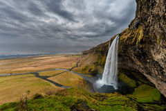Seljalandsfoss Waterfall in Iceland. One of the ost Famous Waterfall in Iceland. Cloudy Sky. Wide Angle. Royalty Free Stock Photos