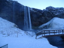 Seljalandsfoss waterfall, iceland. Paisaje navideño de una espectacular cascada royalty free stock image