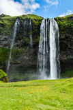 Seljalandsfoss waterfall, Iceland - uncrowded front view. On a sunny summer day Stock Photos