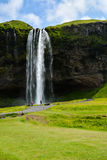 Seljalandsfoss waterfall, Iceland - uncrowded front view. On a sunny summer day Royalty Free Stock Photography
