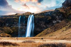 Seljalandsfoss waterfall scenic spot in Iceland famous. For possibility to walk behind stock photo