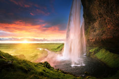 Seljalandsfoss waterfall at sunset Royalty Free Stock Photo