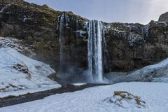 Seljalandsfoss waterfall in winter without people royalty free stock photo