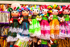 Sell of beautiful colorful mexican dolls in Xohimilco, Mexico. Stock Photos