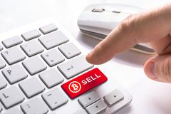 Sell bitcoin currency button. On computer keypad Royalty Free Stock Photography