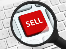 Sell button under the magnifying glass Royalty Free Stock Photo