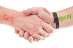 Sell Buy concept using handshake Stock Photo