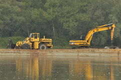 Sell construction and vehicles transported by river barge, with a high water level Royalty Free Stock Photo